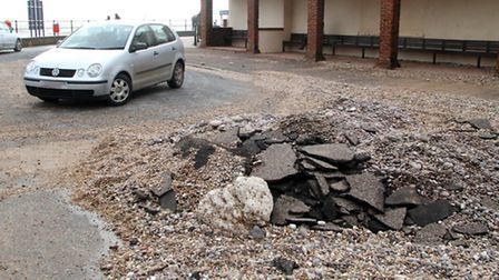 Broken tarmac and stones piled up at the Ham turning point after recent storms. Picture by Alex Walt