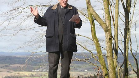 Rev Handel Bennett blesses the copper beech trees at Mutters Moor planted in memory of artist, John