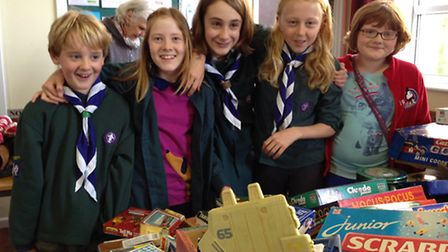 Scouts are celebrating raising £1,000 from jumble