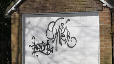 Graffiti on a garage in Bickwell Valley Sidmouth. Photo by Terry Ife. Ref shs 2378-10-14TI