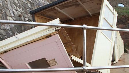 Beach huts damaged at Jacobs Ladder, Sidmouth. Picture by Alex Walton. Ref shs 6102-10-14AW