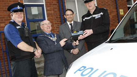 John Hollick hands over a new speed gun to Sgt Andy Squires. PCSO Chris Bolsover and Town Clerk Chri