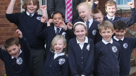 Sidmouth primary head teacher Paul Walker with school children. Photo by Terry Ife ref shs 9719-12-1