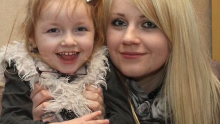 Rosanna Giddings with her daughter Grace. Photo by Simon Horn. Ref shs 3781-08-14SH. To order your c