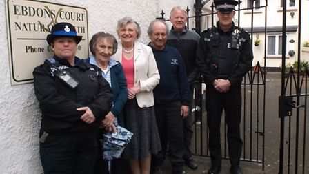 PCSO Jay Bowden, residents Mary Whitfield and Cynthia Watson, Nick Beavis of Sid Valley Metalwork, E