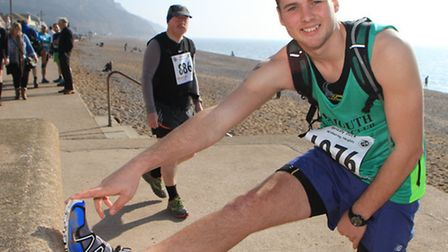 Lewis Brown from Sidmouth Running Club stretches before the Grizzly run. Picture by Alex Walton. Ref