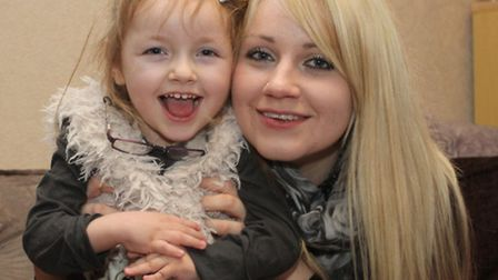 Rosanna Giddings with her daughter Grace. Photo by Simon Horn. Ref shs 3785-08-14SH. To order your c