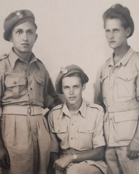 Alan (middle) with two colleagues in British uniform