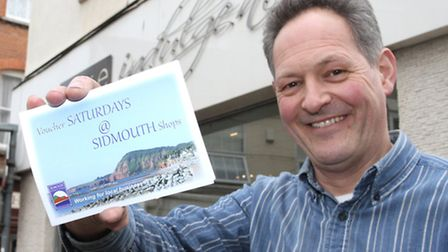 Stephen Kendall-Torry with the Saturday @ Sidmouth vouchers. Photo by Simon Horn. Ref shs 8750-14-14