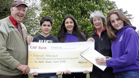 Handell Bennett hands over a cheque to Diana East for the Sidmouth Arboretum at St Johns internation