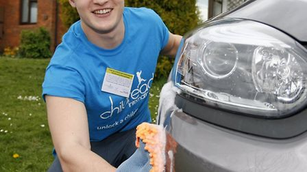 Alex Dunn has been cleaning cars to raise funds for Childreach International before he goes off to E