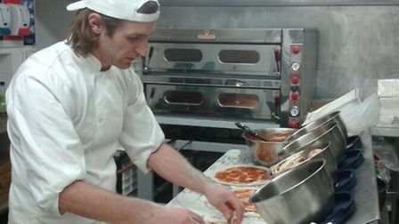 Phil gets to work on pizzas from the new look menu at The Marine