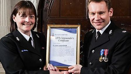 Ottery PC Vicky Dixon receives her award from Superintendent Jim Gale