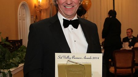 Fields of Sidmouth director Trevor Roberts with the department store's Sid Valley Business Award. Ph