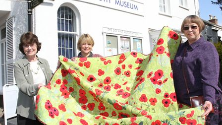 Carole Arnold of the RBL is pictured with Beryl McIndoe and Jenny Moore from the Sidmouth Museum wi