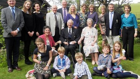 Four generations of the Cobley family. Lt Cdr Kenneth William Cobley is sat in the centre.