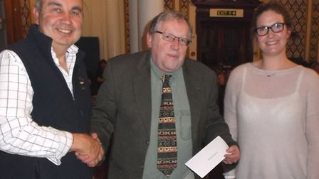 Councillor Simon Pollentine (centre) presenting the cheque for £750 to Steve Smith and Hope Brodie o