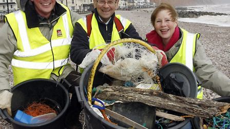 Peter Endersby with Bob and Shirley Huntington during the Sidmouth beach clean up. Photo by Terry If