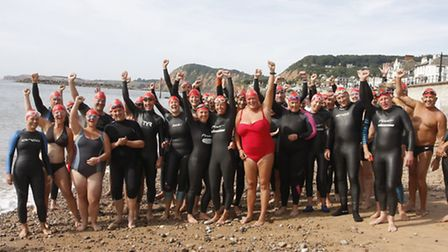 A group photo before the start of the first Sidmouth to Ladram bay swim last year. Photo by Terry If