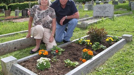 Husband and wife, Phil and Chris at their family grave plot in Sidmouth cemetry. Picture by Alex Wal