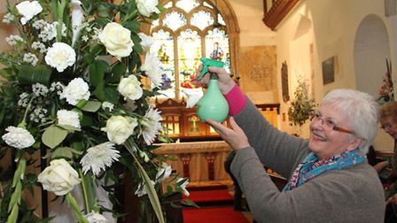 Finishing touches are put to displays from the Festival of Flowers and Memories held in the St Giles
