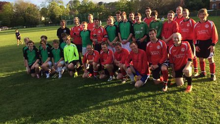 The Sidmouth Town Under-16 team together with the club coaches at the anual fixture which the coache