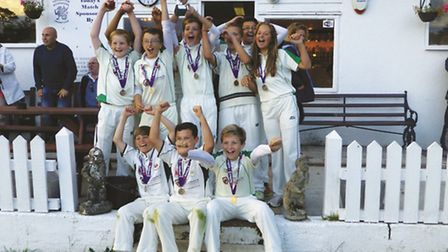 Sidmouth Undfer-13s celebrate lifting the Devon Under-13 Cup
