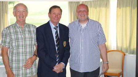 The Sidmouth Centenary celebration's men's winners with the club president.