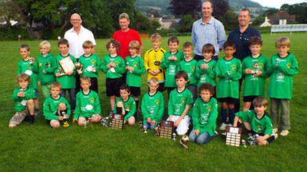 The Sidmouth Town Junior Vikings Under-8s with their end of season trophies