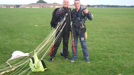 Tony Phillips (right) celebrates after completing his skydive.