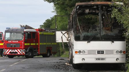 The burnt out coach on the A3052 near to the Beer junction on Monday. Photo by Simon Horn. Ref shs 4