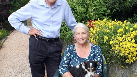 Barbara and Alan Mence with Jessie the dog are looking forward to opening their Woolbrook Park garde