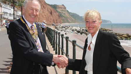 Lynn Ellis hands over the Sidmouth Rotary presidency to Dr Graham Watson this week. Photo by Simon H