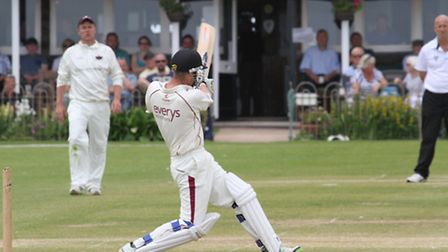 Sidmouth batsman Anthony Griffiths drives the ball towards the pavilion in the game against Exmouth
