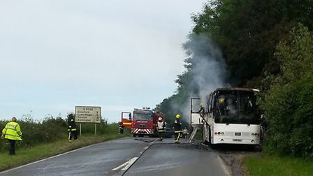A coach that caught fire on the A3052