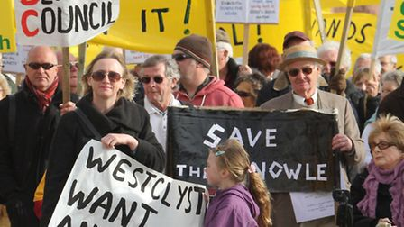 Protesters make their way along Sidmouth seafront on Saturday. Photo by Simon Horn. Ref shs 9494-45-