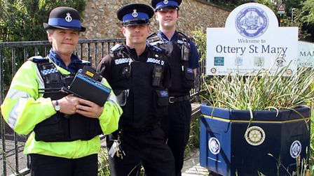 PCSO's Maria Clapp, Steve Trail and Jack Stannard test out Ottery St. Mary's new speed gun. Picture