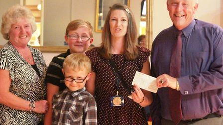 Sidmouth Conservative Club chairman, Derek Truesdale, presents a cheque to Liz McQuiston, Young Care