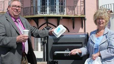 Councillors Peter Sullivan and Frances Newth giving the new bins a go
