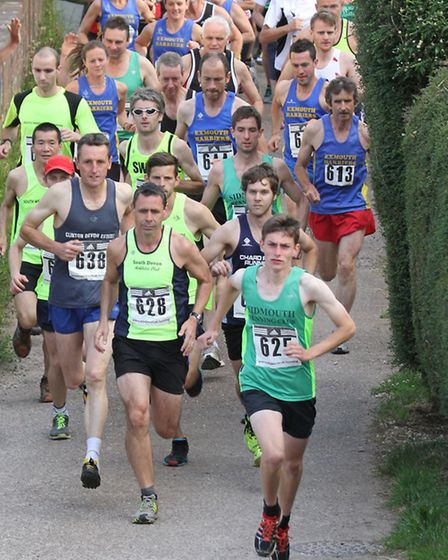 Runners head out from Otterton at the Beat the Bus event from Otterton on Wednesday evening. Photo b