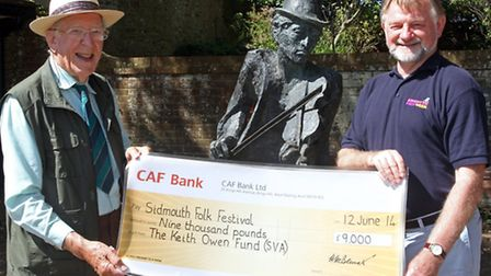 Handel Bennett handing over a cheque to John Braithwaite for the childrens folk festival projects. P