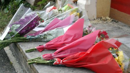 Floral tributes left at the fire-destroyed house in Howarth Close, Sidmouth. Ref shs 5339-25-14AW