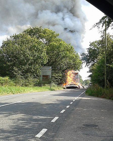 The tractor fire near the Hare and Hounds outside Honiton. Photo by Chris Bastyan.