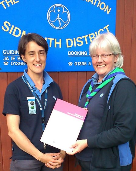 Kate Hamilton, received a 'Going Away' certificate and badge from Helen Kingdon, residential advisor