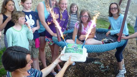 Lucy Beard, 14, is pesented with a celebratory cake after landing a Baden Powell certificate and bad