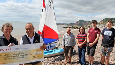 Alan Darrant, chairman of the SVA handing over a cheque to Commadore Steve Smith of Sidmouth Sailing