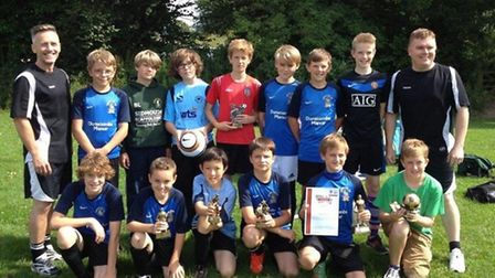 The Sidmouth Town Junior Vikings Raiders and their trophies after their presentations.