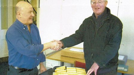 Graham Cooper handing over the slide collection to English Heritage Archivist Ian Leith