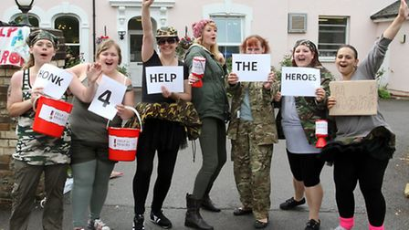 Staff taking part in a 12 hour dance-a-thon at Roselands Lodge for armed forces day. Photo by Terry
