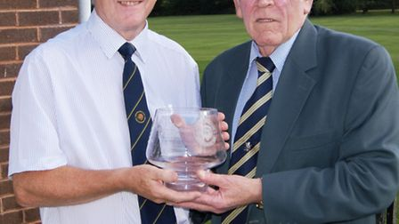 The captains of Sidmouth and Honiton Golf Clubs, Colin Macklin and Phil Wall with the trophy that th